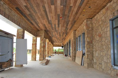 Outdoor Patio Wood Ceiling by Outdoor Distressed Wood Planking Mediterranean Porch