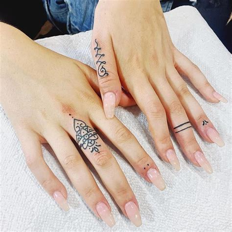 female finger tattoos thumb and finger tattoos golfian