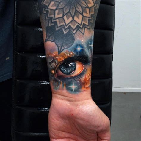 space eye tattoo on guy s wrist best tattoo design ideas