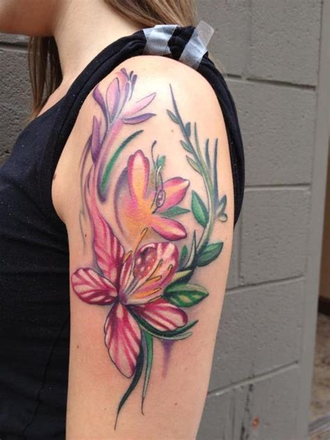 flower tattoo on upper arm 34 lily flowers tattoos on arm