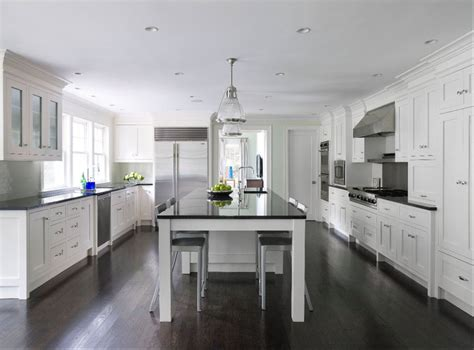 white kitchen cabinets wood floors transitional