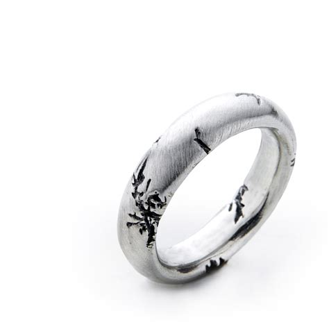 chunky men s silver ring features black cracks in satin