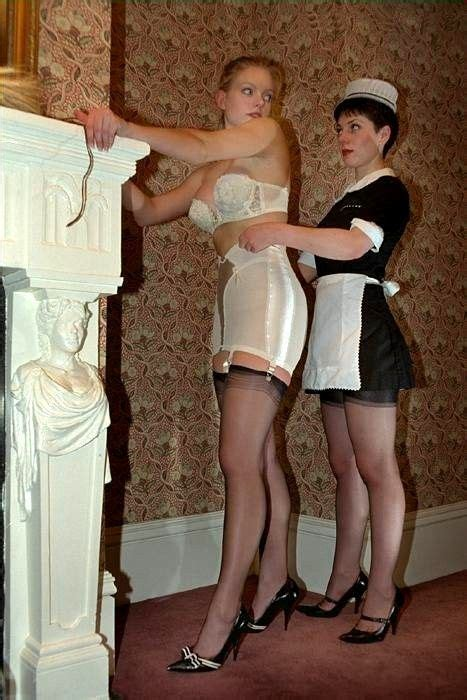 open bottom girdles stockings and garters french maid helping mistress into white open bottom garter