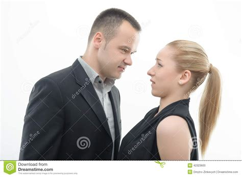 woman dominates husband colleagues shouting against each other on white stock
