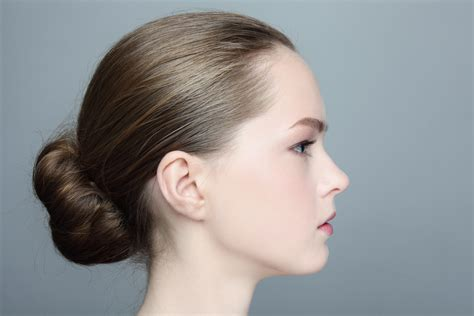 side view of pulled back hair in a bun lionesse flat iron wake up to great hair