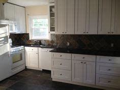 bar höhe kitchen island sherwin williams dorian gray cabinets and urbane bronze
