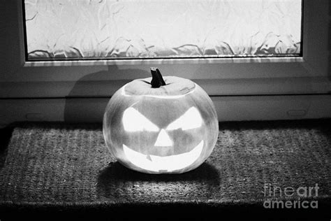 how to ward off spirits in your house illuminated halloween pumpkin jack o lantern outside a house to ward off evil spirits