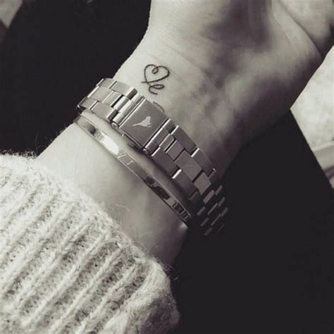 smile wrist tattoo wrist saying le and drawing a as the