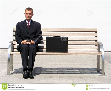 sitting on bench businessman sitting on bench stock photo image 227500