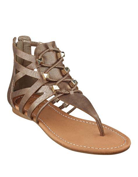 beige gladiator sandals guess glando gladiator sandals in beige bronze lyst