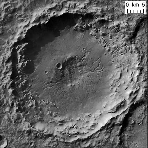 pit moon and fluvial channels in central pit craters planetary