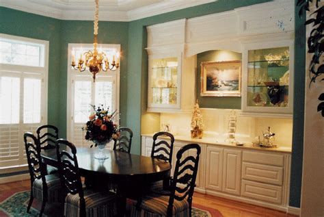built in cabinetry and glass display units for dining
