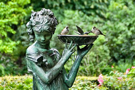 how to use statues and sculptures to make your garden stand out bridgman