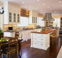 Kitchen island with wood countertop contrasts beautifully craft maid