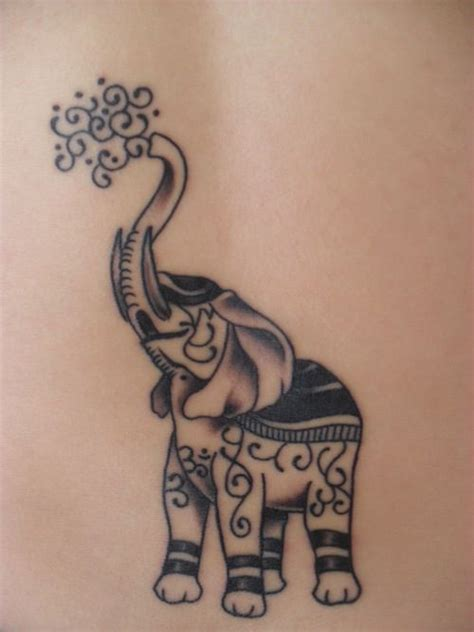 elephant tattoo with trunk up meaning elephants with their trunk up mean good luck tattoo