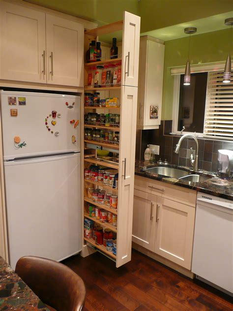 narrow kitchen cabinet the narrow cabinet beside the fridge pulls out to reveal a