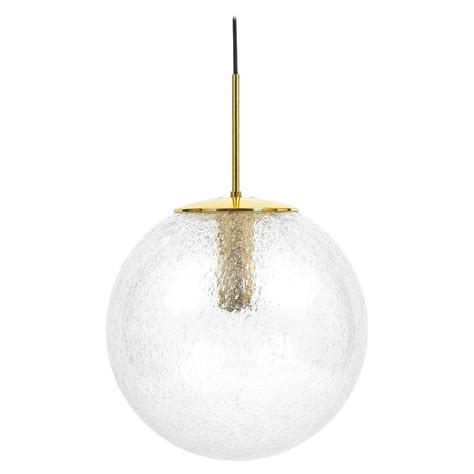 brass and glass pendant large glass and brass globe pendant by limburg for sale at