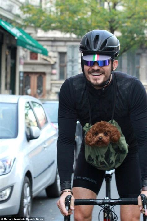 orlando bloom puppy orlando bloom takes his dog mighty cycling through prague