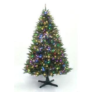 rotating prelit christmas trees at kmart showtime 7 pre lit peak tree