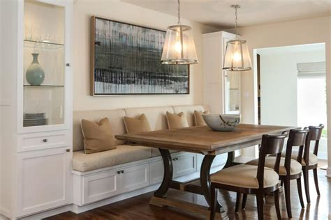 banquette seating dining room a built in banquette is flanked by tall glass cabinets for