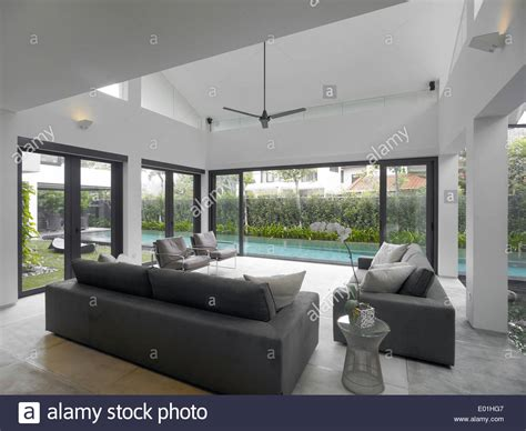 living room with view of swimming pool in modern house