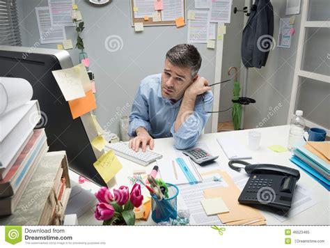 Office Worker At Desk Avg Starting Salary Comp Eng Vs Investment Banking
