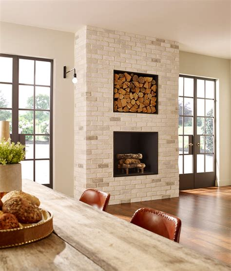 contemporary white kitchen brick fireplace