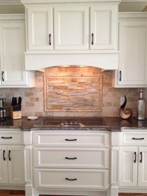 Custom kitchen cabinetry, travertine and ledger stone