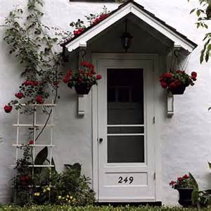 entryway overhang bedecked with roses front entries this house