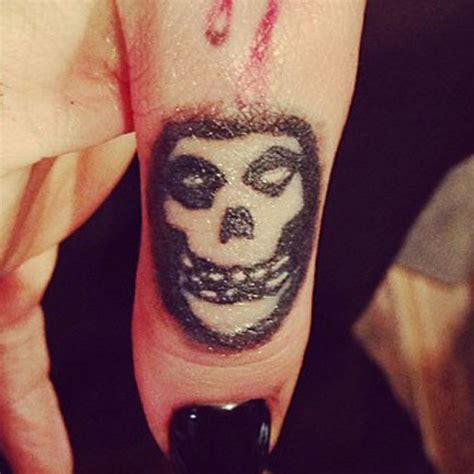 ash tattoo ash costello logo skull knuckle style