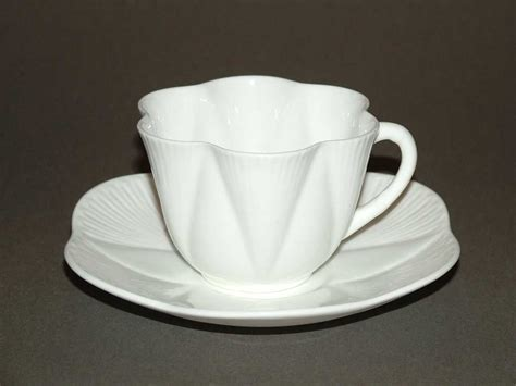 design cups file cup and saucer dainty white design by rowland morris