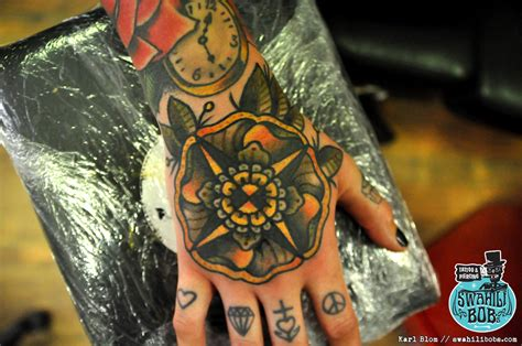 old school tattoo in hand old school traditional flower hand tattoo by karl blom