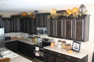 decorating ideas for the top of kitchen cabinets pictures lanterns on top of kitchen cabinets decor ideas jars pumpkins and