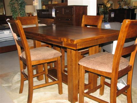 counter height table with upholstered chairs kalamazoo dining room furniture dining room sets