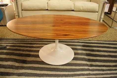 saarinen low oval coffee table white base rosewood knoll