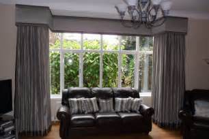 Dress your large square bay window with a simple but stylish curtain