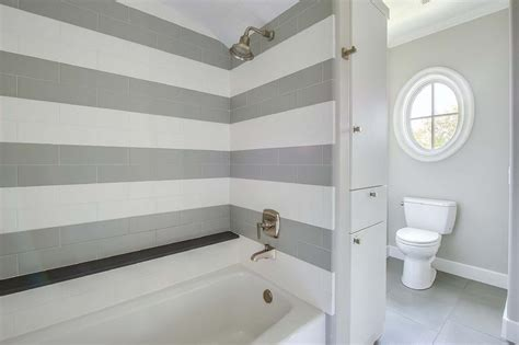 grey and white striped bathroom shower with striped tiles transitional bathroom