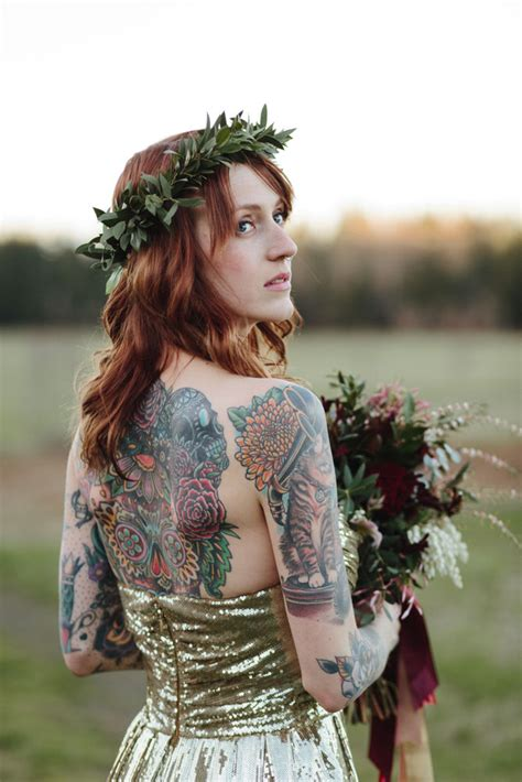 tattooed bride horses a gold wedding dress and a stunning tattooed