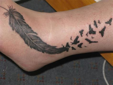 small bird tattoo on ankle black flying birds and forest on arm by mariedamn