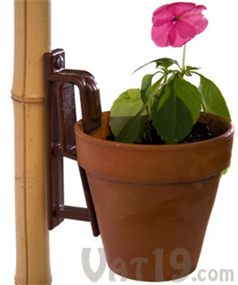 hanging flower pot hooks the pot latch hang pots from nearly any vertical surface