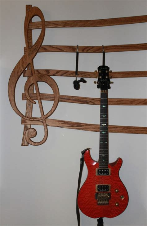 Multi Guitar Wall Rack by Wall Mounted Multi Guitar Wall Hanger Aftcra