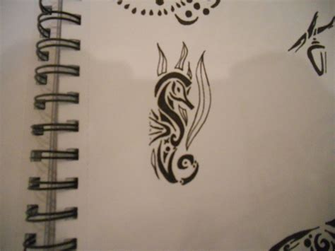 the bend seahorse tattoo designs