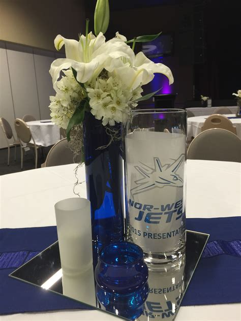 centerpieces for corporate events corporate blue themed afl centrepieces by rocket event services see more at www rocketevents