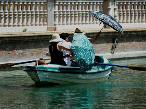 boat ride seville heatwave sees temperatures approach europe record of 48c
