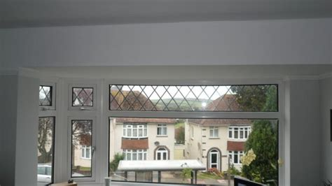 roof curtain rail curtain rail in a bay window with a flat roof and no