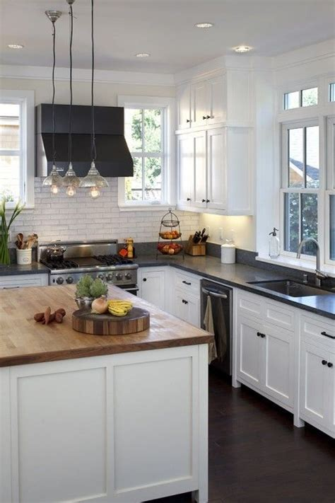 butcher block island and white kitchen for the home