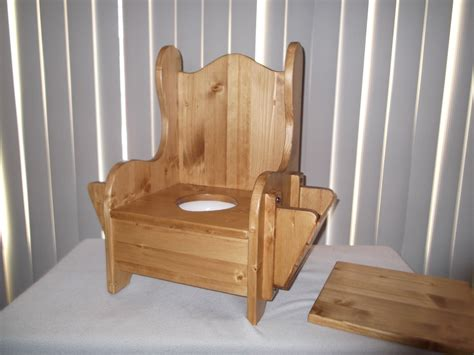 Wood Potty Chair by Wooden Potty Chair W Tp Holder And Book Rack