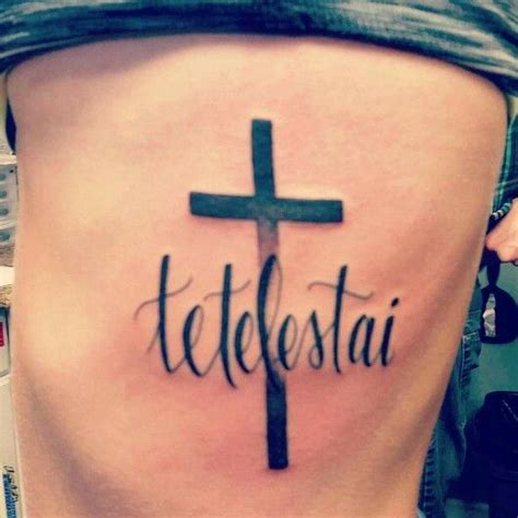 cross with words tattoo word tetelestai quot it is finished quot cross rib
