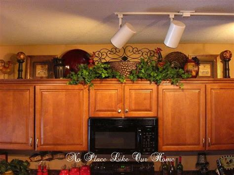 decorating ideas for kitchen cabinets tuscan above the kitchen cabinets for the home