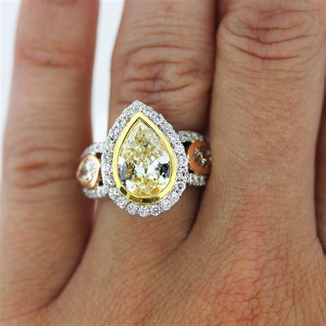 yellow pear shaped engagement ring diamondstud
